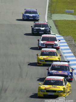 Tom Kristensen leads a group of cars