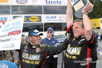 Tony and Don Schumacher celebrate winning the Top Fuel championship