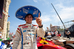 Sergio Perez celebrates his pole position