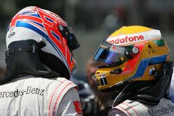Third place Jenson Button, McLaren Mercedes and second place Lewis Hamilton, McLaren Mercedes