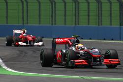 Lewis Hamilton, McLaren Mercedes leads Fernando Alonso, Scuderia Ferrari