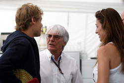 Sebastian Vettel, Red Bull Racing, Bernie Ecclestone, and Fabiana Flosi Brazilian Grand Prix Vice-President of Marketing and girlfriend of Bernie Ecclestone
