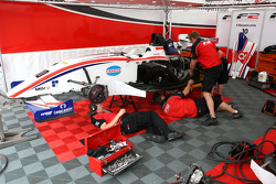 F2 mechanics work on the car of Benjamin Lariche