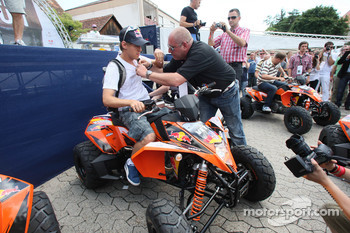 Sebastian Vettel, Red Bull Racing, on a quad