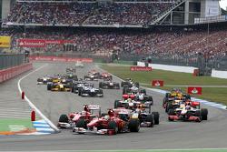 Felipe Massa, Scuderia Ferrari leads Fernando Alonso, Scuderia Ferrari and Sebastian Vettel, Red Bull Racing at the start