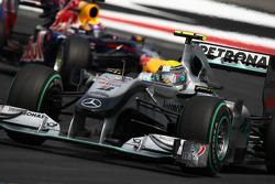 Nico Rosberg, Mercedes GP leads Mark Webber, Red Bull Racing