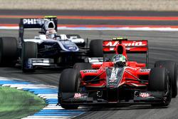 Lucas di Grassi, Virgin Racing leads Nico Hulkenberg, Williams F1 Team