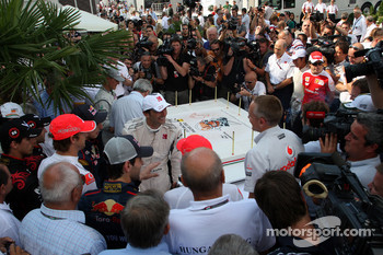 Drivers gather to celebrate the 25th anniversary of the circuit with a big cake