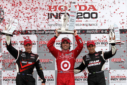 Podium: race winner Dario Franchitti, Target Chip Ganassi Racing, second place Will Power, Team Penske, third place Helio Castroneves, Team Penske