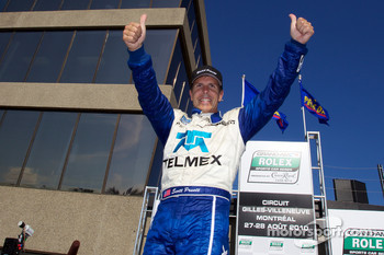 Race winner Scott Pruett celebrates