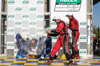DP podium: class and overall winners Scott Pruett and Memo Rojas, second place Jon Fogarty and Alex Gurney