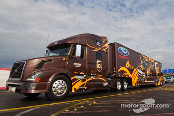 The UPS hauler pulls into the track