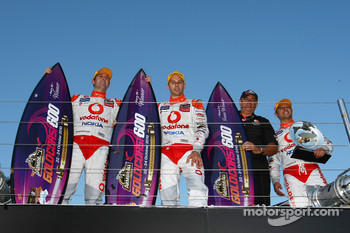 Jamie Whincup, Steve Owen with TeamVodafone Boss Roland Dane and top placed international driver Andy Priaulx celebrate after race two of the Gold Coast 600