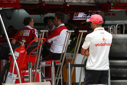 Lewis Hamilton, McLaren Mercedes watches the Ferrari team at work