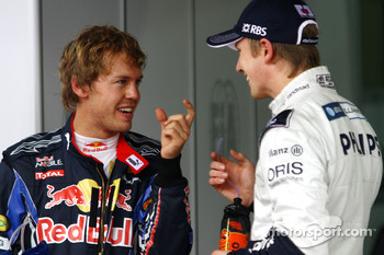 Pole winner Nico Hulkenberg, Williams F1 Team, with second place Sebastian Vettel, Red Bull Racing