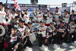 NASCAR Nationwide Series 2010 champion Brad Keselowski celebrates with Roger Penske and his team