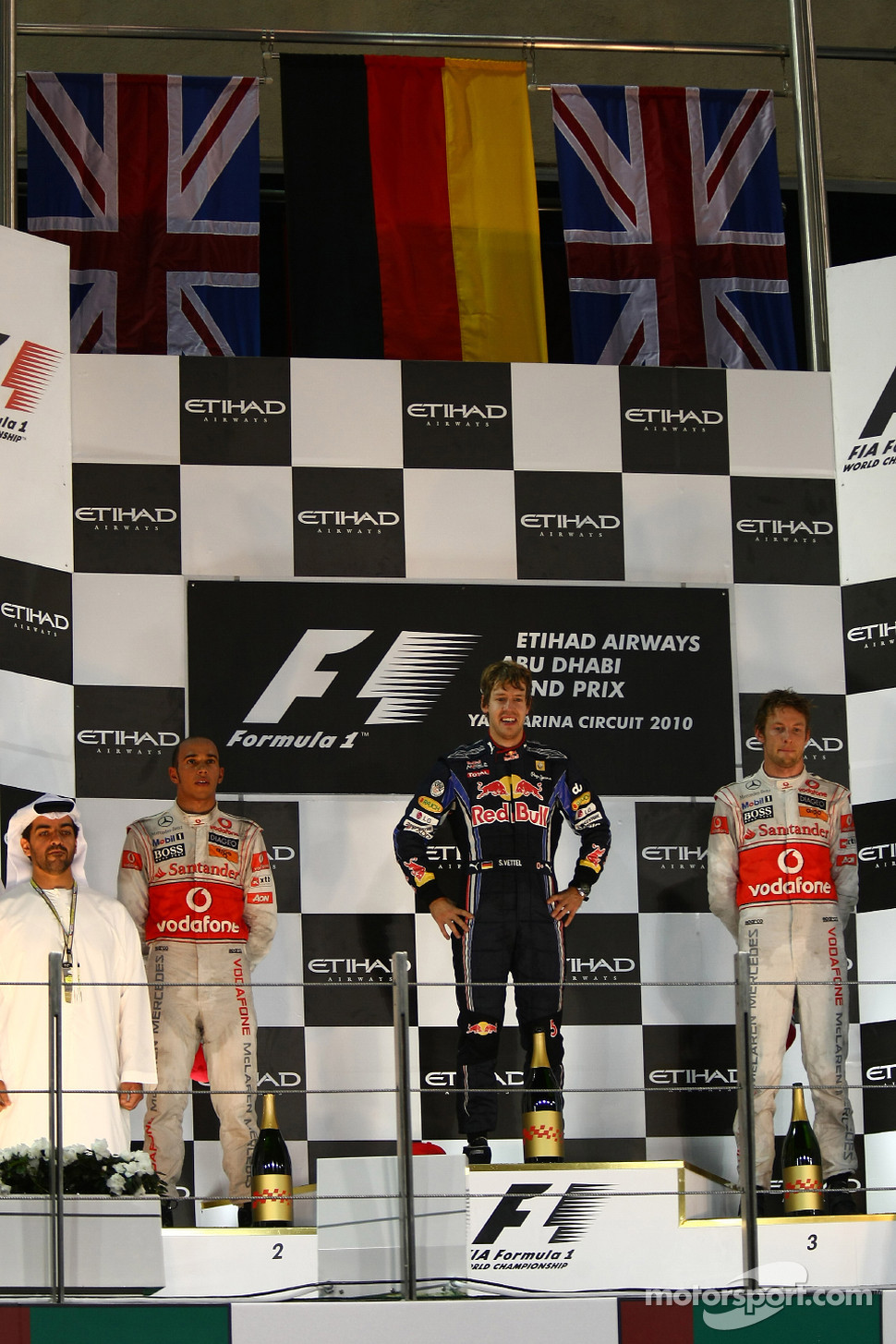 Podium: race winner and 2010 Formula One World Champion Sebastian Vettel, Red Bull Racing, second place Lewis Hamilton, McLaren Mercedes, third place Jenson Button, McLaren Mercedes
