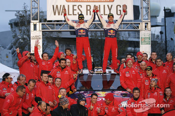 Podium: winners Sébastien Loeb and Daniel Elena celebrate witth Citroën Total World Rally team members
