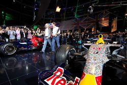 Chief technical officer Adrian Newey, team principal Christian Horner and a car of Red Bull Racing