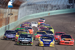Carl Edwards, Roush Fenway Racing Ford and Martin Truex Jr., Michael Waltrip Racing Toyota battle for the lead