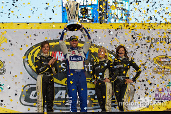 Championship victory lane: NASCAR Sprint Cup Series 2010 champion Jimmie Johnson, Hendrick Motorsports Chevrolet celebrates with the lovely Miss Sprint Cup