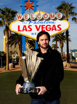 Five-time NASCAR Sprint Cup Series Champion Jimmie Johnson poses with the 2010 trophy