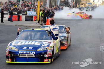 Jimmie Johnson watches as Kevin Harvick performs a burnout