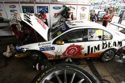Team mechanics work on the car of James Courtney, #18 Jim Beam Racing