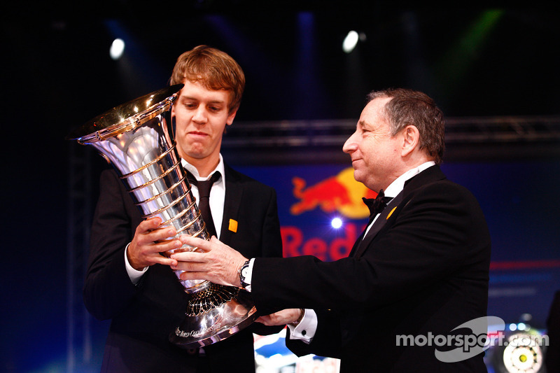 FIA President Jean Todt presents Formula One World Champion Sebastian Vettel with the Drivers' trophy