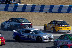 #40 Berg Racing Mazda RX-8: Robert Mitten, John Weisberg spins in the middle of the field