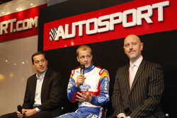Mikko Hirvonen, flanked by Castrol's Donald Smith and Ford's Gerard Quinn answers questions on stage at the 2011 Autosport International Show in Birmingham