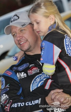 "Robert Hight celebrates with his daughter ""Amber' after winning the funny car category at the Kragen Oreilly Auto Parts NHRA Winternationals"