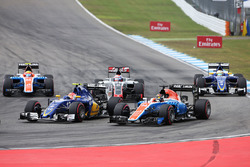 Felipe Nasr, Sauber C35 and Pascal Wehrlein, Manor Racing MRT05 at the start of the race