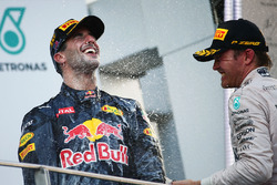Race winner Daniel Ricciardo, Red Bull Racing celebrates on the podium with third placed Nico Rosberg, Mercedes AMG F1