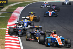 Esteban Ocon, Manor Racing MRT05 leads Carlos Sainz Jr., Scuderia Toro Rosso STR11 and Fernando Alonso, McLaren MP4-31