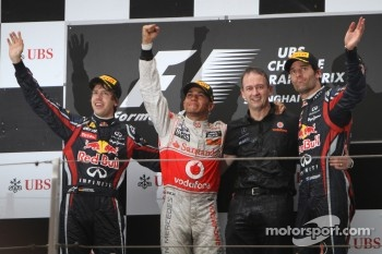 Podium: race winner Lewis Hamilton, McLaren Mercedes, with second place Sebastian Vettel, Red Bull Racing, and third place Mark Webber, Red Bull Racing
