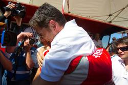GT pole winner Gianmaria Bruni celebrates with Giancarlo Fisichella