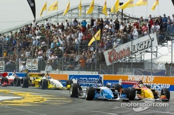 Paul  Tracy leads Sbastien Bourdais into turn 1