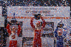 Podium: race winner Justin Wilson with Sébastien Bourdais and A.J. Allmendinger