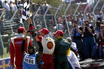 Race winner Sbastien Bourdais celebrates with Justin Wilson and Alex Tagliani