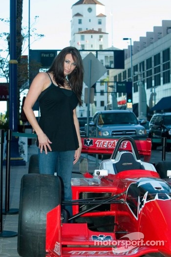 Tecate model poses with car on Pine Street