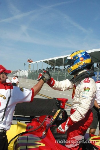 Sbastien Bourdais accepts congratulations from his team after winning the provisional pole