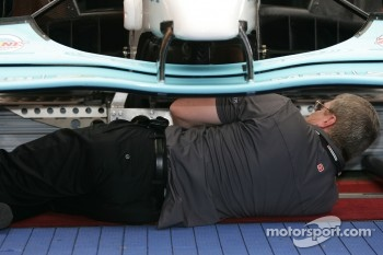 Champ Car tech inspection team member at work