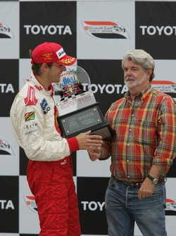 Podium: race winner Sébastien Bourdais celebrates with George Lucas