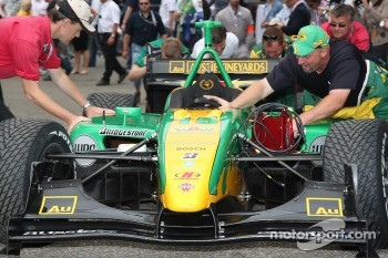 Team Australia team members push the car