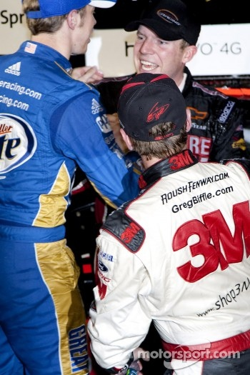 Victory lane: race winner Regan Smith, Furniture Row Racing Chevrolet celebrates with Brad Keselowski, Penske Racing Dodge and Greg Biffle, Roush Fenway Racing Ford