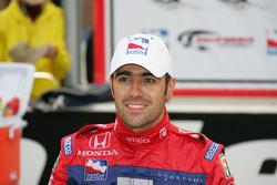 Race winner Dario Franchitti celebrates