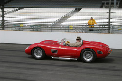 Dean Kruse of Kruse Auction fame in his Ferrari takes a lap around the oval