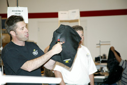 An Impact Racing representative demonstrates the heat-resistant qualities of one of the company's products