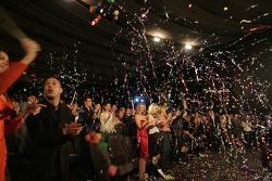 The crowd celebrates as Dan Wheldon accepts his championship trophy